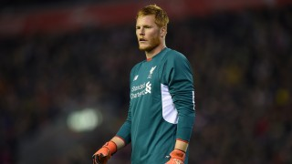 Liverpool's Hungarian goalkeeper Adam Bogdan watches his teammates during the English League Cup fourth round football match between Liverpool and Bournemouth at Anfield stadium in Liverpool, north west England on October 28, 2015. AFP PHOTO / PAUL ELLIS  RESTRICTED TO EDITORIAL USE. NO USE WITH UNAUTHORIZED AUDIO, VIDEO, DATA, FIXTURE LISTS, CLUB/LEAGUE LOGOS OR 'LIVE' SERVICES. ONLINE IN-MATCH USE LIMITED TO 75 IMAGES, NO VIDEO EMULATION. NO USE IN BETTING, GAMES OR SINGLE CLUB/LEAGUE/PLAYER PUBLICATIONS.