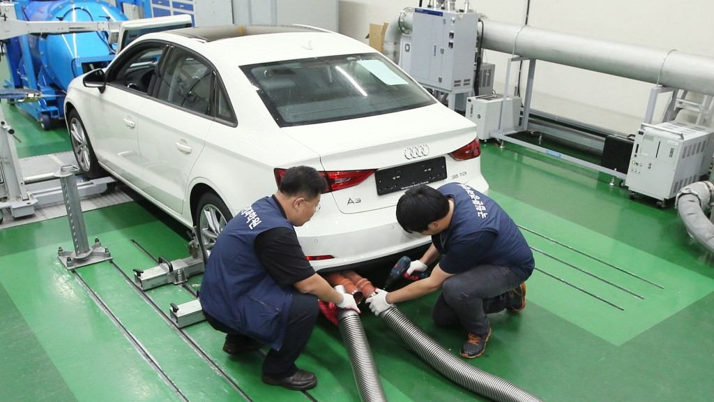 Technicians conduct an emmissions test on an Audi vehicle at the National Institute of Environmental Research Transport Institute in Incheon on October 1, 2015. Volkswagen plans to recall as many as 120,000 diesel cars sold in South Korea, officials said, as part of its global response to a damaging pollution-cheating scandal. The Environment Ministry announced the start of emissions tests on a number of Volkswagen models sold in the Korean market, including the Golf, Audi A3, Jetta and Beetle. REPUBLIC OF KOREA OUT NO ARCHIVES RESTRICTED TO SUBSCRIPTION USE AFP PHOTO / YONHAP