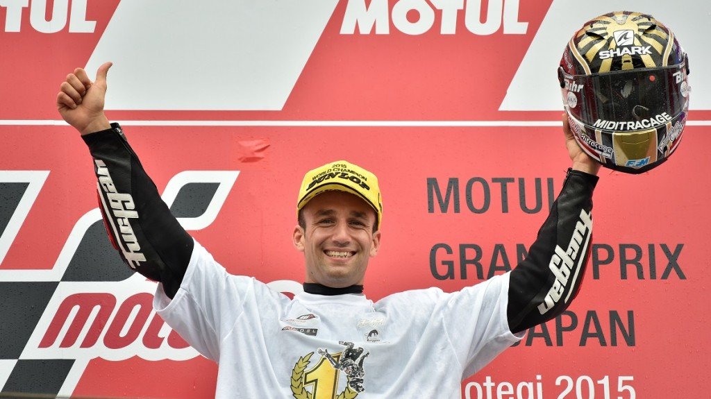 Ajo Motorsport rider Johann Zarco of France celebrates his victory on the podium during the awards ceremony for the Moto2-class race at the Japanese Grand Prix in Motegi, Tochigi prefecture on October 11, 2015.     AFP PHOTO / KAZUHIRO NOGI