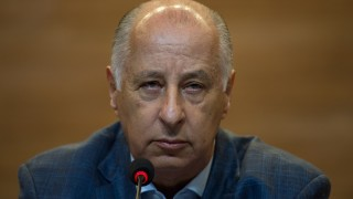 The president of the Brazilian Football Confederation (CBF) Marco Polo Del Nero speaks to the media after former CBF President Jose Maria Marin was arrested in a FIFA corruption scandal,  at th CBF's headquarters at Rio de Janeiro, Brazil, on May 29, 2015. Del Nero said Friday he knew nothing about bribes allegedly paid to his arrested deputy Jose Maria Marin, rejecting calls to resign.  AFP PHOTO / YASUYOSHI CHIBA