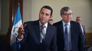 President elect Jimmy Morales (L) and Vice President elect Jafeth Cabrera of the National Front Convergence arrive to a press conference in Guatemala city on October 26, 2015. Morales, a comic actor and TV personality, declared victory as election officials released the resounding results: 68 percent of the vote for the conservative candidate to 32 percent for former first lady Sandra Torres, with 97 percent of polling stations reporting. AFP PHOTO / JOHAN ORDONEZ