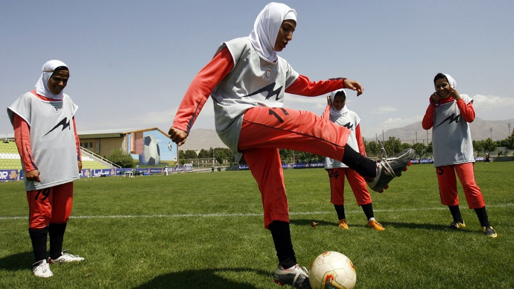Players of Iran's women national football team warm-up before their friendly football match with club Malavan Anzali women's team in Tehran on June 25, 2009. The head of Iran's football federation has denied punishing players for wearing green wristbands in a show of support of the opposition during a World Cup qualifier, local media reported. AFP PHOTO/ISNA/AMIR POORMAND