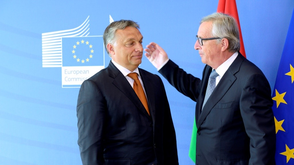 Hungary's Prime Minister Viktor Orban (L) is greeted by European Union Commission President Jean-Claude Juncker of Luxembourg prior to their meeting at the European Union Commission headquarter in Brussels on September 3, 2015. Orban warned on September 3 that the wave of mostly Muslim refugees coming to Europe threatens to undermine the continent's Christian roots -- an idea rejected by German Chancellor Angela Merkel -- and insisted the migrant crisis was a German problem, not a European one as he defended his government's handling of thousands of refugees flooding into his country.  AFP PHOTO / THIERRY CHARLIER