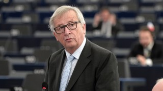 European Commission President Jean-Claude Juncker (L) speaks during a debate on measures to deal with the unprecedented refugee crisis next to First Vice-President of the European Commission Frans Timmermans at the European Parliament in Strasbourg, eastern France, on October 6, 2015. AFP PHOTO / FREDERICK FLORIN