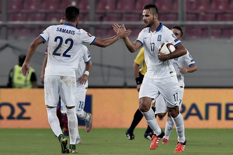 Greece's Panagiotis Tachtsidis (R) celebrates with Greece's Andreas Samaris (L) after scoring a goal during the UEFA Euro 2016 qualifying Group F football match between Greece and Hungary  on October 11, 2015 at the Georgios Karaiskakis stadium in Athens. AFP PHOTO / ANGELOS TZORTZINIS