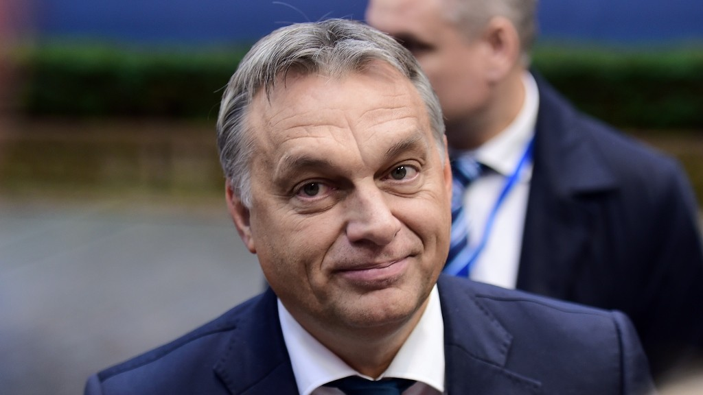 Hungarian Prime Minister Viktor Orban arrives to take part in a European Union (EU) summit dominated by the migration crisis at the European Council in Brussels, on October 15, 2015. AFP PHOTO/EMMANUEL DUNAND