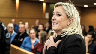 "France far-right leader Marine Le Pen arrives to court on October 20, 2015 in Lyon, to face charges of inciting racial hatred after comparing Muslim street prayers to the Nazi occupation. Le Pen was campaigning to take over leadership of the Front National (FN) from her father in December 2010 when she made the comparison, complaining that there were ""10 to 15"" places in France where Muslims worshipped in the streets outside mosques when they were full. AFP PHOTO / JEAN-PHILIPPE KSIAZEK"