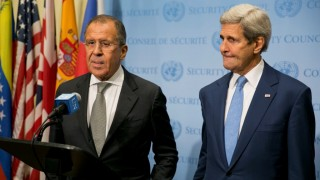 "US Secretary of State John Kerry (R) and Russia Foreign Minister Sergey Lavrov speak to the media after a meeting concerning Syria at the United Nations headquarters in New York on September 30, 2015. Russia's air strikes in Syria targeted opposition forces and not Islamic State jihadists, a US defense official said, contradicting Russian claims. At the United Nations in New York, Secretary of State John Kerry made clear that Washington would have ""grave concerns"" should Moscow opt to strike targets in areas where IS fighters and Al-Qaeda-linked groups are not operating. AFP PHOTO/Dominick Reuter"
