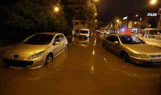 Cars are seen on a flooded street on October 03, 2015 in Nice, southeastern France.  AFP PHOTO / VALERY HACHE