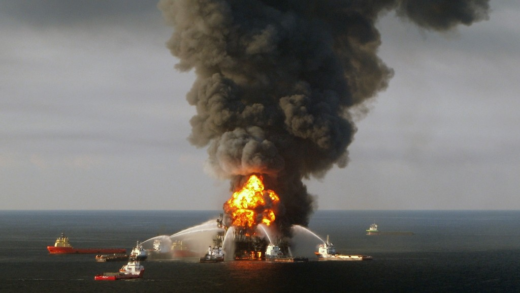 """(FILES) A file photo taken on on April 21, 2010 shows a US Coast Guard handout image of fire boat response crews as they battle the blazing remnants of the BP operated off shore oil rig, Deepwater Horizon, in the Gulf of Mexico.  British energy giant BP will pay a record $20.8 billion to settle government claims for damages stemming from the deadly 2010 Gulf of Mexico oil spill, US Attorney General Loretta Lynch said October 5, 2015.""""This historic resolution is a strong and fitting response to the worst environmental disaster in American history,"""" Lynch said at a press conference. """"BP is receiving the punishment it deserves, while also providing critical compensation for the injuries it caused to the environment and the economy of the Gulf region.""""    AFP PHOTO/US COAST GUARD/RESTRICTED TO EDITORIAL USE"""