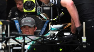 Mercedes AMG Petronas driver Nico Rosberg of Germany talks with a team technician in the pits during preparations before the United States Formula One Grand Prix at the Circuit of The Americas in Austin, Texas on October 22, 2015.                        AFP PHOTO / MARK RALSTON