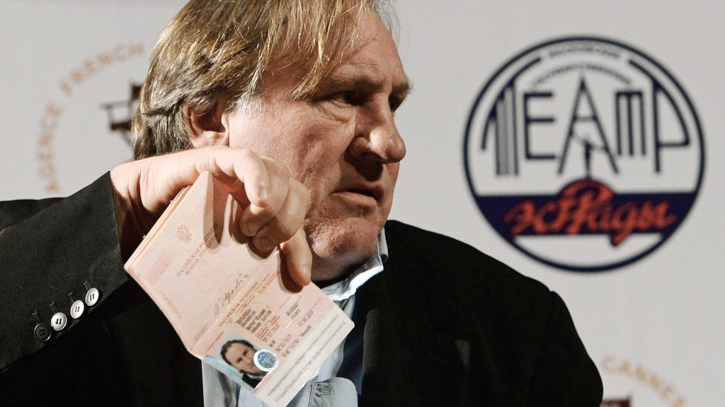 """2713474 10/07/2015 Actor Gerard Depardieu shows his passport of Russia's citizen during a briefing held ahead of the premiere of """"La Musica Deuxieme"""" at the Moscow State Estrada Theater. Ramil Sitdikov/RIA Novosti"""