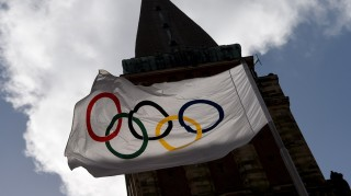 The Olympic flag from 1972 sways in the wind in front of the town hall in Kiel, Germany, 13 April 2015. The sailing regatta is envisioned to take place in Kiel, should the city of Hamburg make the race to host the 2024 Olympics, the German Olympic Sports Federation (Deutscher Olympischer Sportbund, DOSB) and the German sailing federation (Deutschen Segler-Verbands, DSV) announced in a joint press conference in Hamburg, 13 April 2015.Photo: Carsten Rehder/dpa