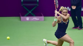(151014) -- TIANJIN, Oct. 14, 2015 (Xinhua) -- Timea Babos of Hungary returns the ball during the second round match against Alison Riske of the United States at the Tianjin Open tennis tournament in Tianjin, China, Oct. 14, 2015. (Xinhua/Yue Yuewei)
