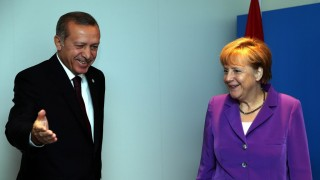 NEWPORT, WALES - SEPTEMBER 5:  Turkish President Recep Tayyip Erdogan (R) meets German Chancellor Angela Merkel in Newport, Wales, on September 5, 2014. Erdogan in Newport for a two-day NATO summit held at the Celtic Manor Resort on September 4-5. (Kayhan Ozer - Anadolu Agency)