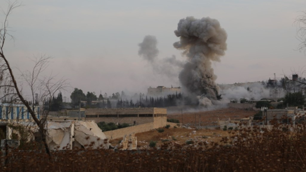 ALEPPO, SYRIA - OCTOBER 06:  Smoke rises after Russian airtrikes hit  ammunition-stores and bases of two opposition groups, in Mansoura region in the west of Aleppo, Syria on October 06, 2015. Abdulfetah Huseyin / Anadolu Agency