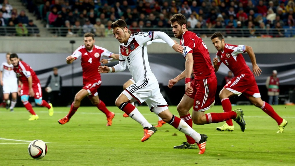LEIPZIG, GERMANY - OCTOBER 11:  Mesut Ozil of Germany (L) in action during the Euro 2016 group D qualifying football match between Germany and Georgia on October 11, 2015 at the Leipzig stadium in Leipzig, Germany. Mehmet Kaman / Anadolu Agency