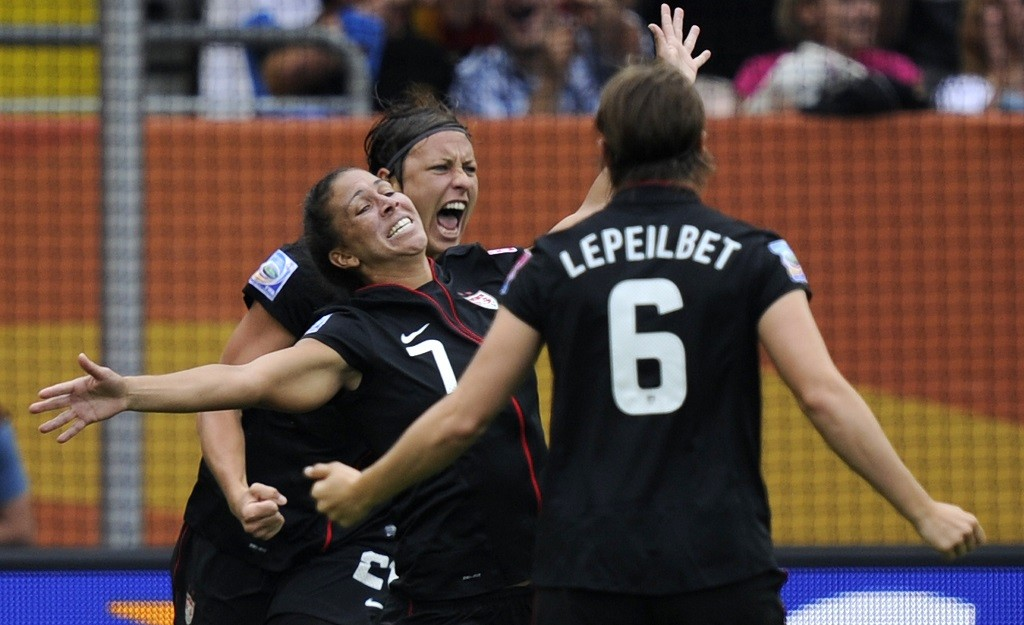 USA's striker Abby Wambach (C), USA's defender Amy Le Peilbet (R) and USA's midfielder Shannon Boxx (L) celebrate after Brazil scored the 0-1 own goal during the quarter-final match of the FIFA women's football World Cup Brazil vs USA on July 10, 2011 in Dresden, eastern Germany.  AFP PHOTO / ODD ANDERSEN