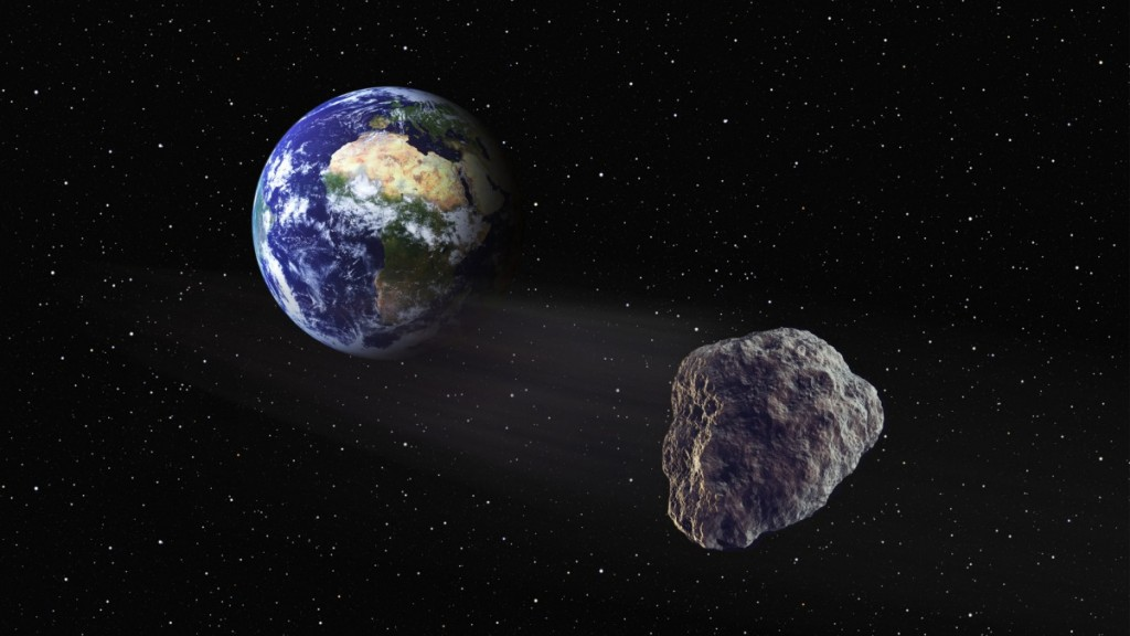 Asteroid flowing past Earth seen from the space. Computer manipulated image, digital creation. © Manuel Cohen / Fizzfoto
