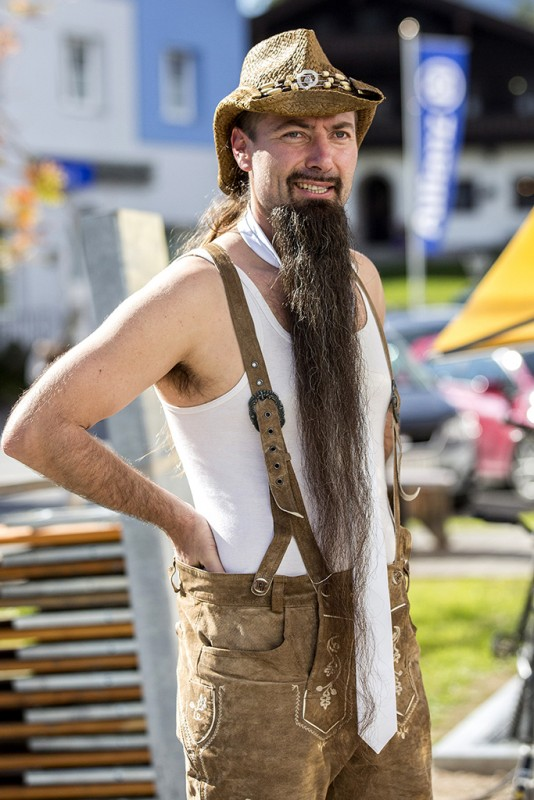 LEOGANG, AUSTRIA - OCTOBER 3:  A contestant of the World Beard And Mustache Championships poses for a picture during a break of the Championships 2015 on October 3, 2015 in Leogang, Austria. Over 300 contestants in teams from across the globe have come to compete in sixteen different categories in three groups: mustache, partial beard and full beard. The event takes place every few years at different locations worldwide. (Photo by Jan Hetfleisch/Getty Images)