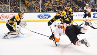 BOSTON, MA - OCTOBER 21 : Claude Giroux #28 of the Philadelphia Flyers dives to shoot the puck against Tuukka Rask #40 and Torey Krug #47 of the Boston Bruins at the TD Garden on October 21, 2015 in Boston, Massachusetts.  (Photo by Brian Babineau/NHLI via Getty Images)