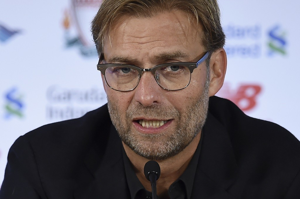 """Liverpool's new German manager Jurgen Klopp speaks at a press conference to announce his new appointment at Anfield in Liverpool, northwest England, on October 9, 2015. Klopp described his job as """"the biggest challenge"""" in world football on October 9 following his appointment as the successor to Brendan Rodgers. Former Borussia Dortmund head coach Klopp, 48, was appointed on October 8 on a three-year contract following the dismissal of Rodgers, who was sacked October 4 after three and a half years at the club.  AFP PHOTO / PAUL ELLIS    RESTRICTED TO EDITORIAL USE. No use with unauthorized audio, video, data, fixture lists, club/league logos or 'live' services. Online in-match use limited to 75 images, no video emulation. No use in betting, games or single club/league/player publications."""