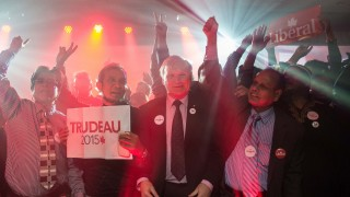 Supporters of Canadian Liberal Party leader Justin Trudeau cheer as results show the Liberals ahead in the general elections in Montreal on October 19, 2015. Trudeau's Liberals have won Canada's legislative elections, according to TV projections.    AFP PHOTO/NICHOLAS KAMM