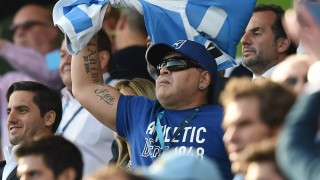 Former Argentina football international Diego Maradona waves a flag before a Pool C match of the 2015 Rugby World Cup between Argentina and Tonga at Leicester City Stadium in Leicester, central England, on October 4, 2015. AFP PHOTO / PAUL ELLIS RESTRICTED TO EDITORIAL USE, NO USE IN LIVE MATCH TRACKING SERVICES, TO BE USED AS NON-SEQUENTIAL STILLS