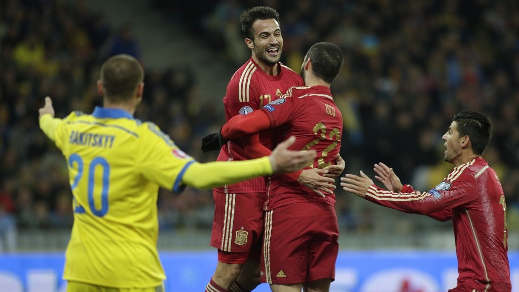 Spain's defender Mario Gaspar Perez (2nd L) celebrates after scoring during the Euro 2016 qualifying football match between Ukraine and Spain at Olympiysky stadium in Kiev on October 12, 2015.  AFP PHOTO / ANATOLII STEPANOV