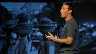 US chairman and chief executive of Facebook Mark Zuckerberg gestures as he announces the Internet.org Innovation Challenge in India in New Delhi on October 9, 2014. Zuckerberg is attending a two-day Internet.org summit which will discuss ways to make internet access available to people who cannot afford it globally. AFP PHOTO / CHANDAN KHANNA