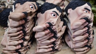 """Masks of Mexican drug trafficker Joaquin Guzman Loera, aka """"El Chapo"""", are pictured in a factory of costumes and marsks on October 16, 2015, in Jiutepec, Morelos State. AFP PHOTO/RONALDO SCHEMIDT"""