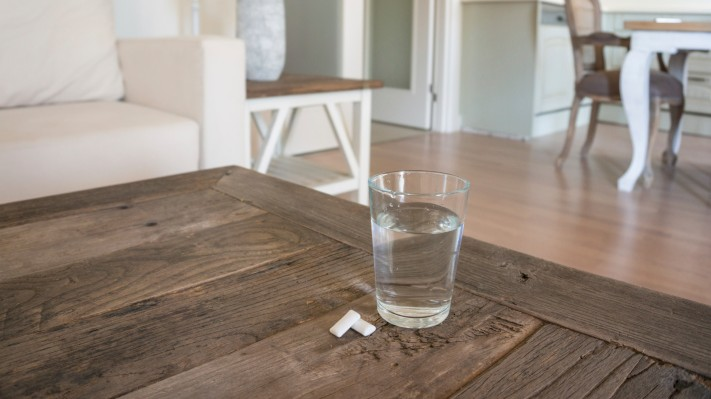 glass of water on table in a living room