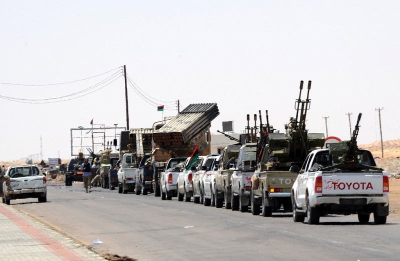 Libyan rebel fighters with their trucks mounted with heavy weapons wait to head towards the front line outside the Libyan eastern city Ajdabiya on May 10, 2011. AFP PHOTO / SAEED KHAN