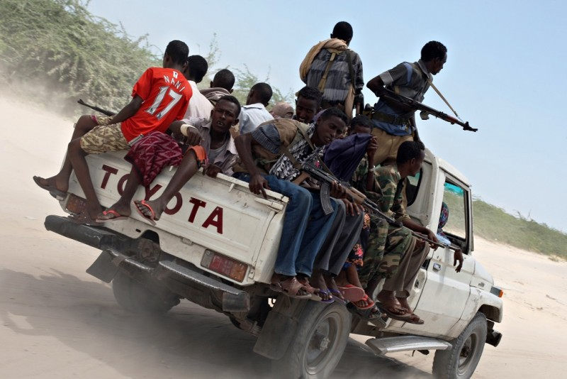 Government soldiers ride a pick-up truck as they head to a frontline section at KM4 X-Control section of Mogadishu where earlier Islamist Fighters belonging to the Al-Shabab attacked the stronghold of the Government positions in the early hours in the morning on December 01, 2009. Somalia has been embroiled in conflict since 1991, but Western nations fearful of the country becoming an Al-Qaeda safe haven hoped a government they backed led by Somali President Sharif Sheikh Ahmed would be able to restore some semblance of order. Instead, an offensive earlier this year by two Islamist groups has left the transitional government with control of only a small part of the Somali capital.   AFP PHOTO/MOHAMED DAHIR