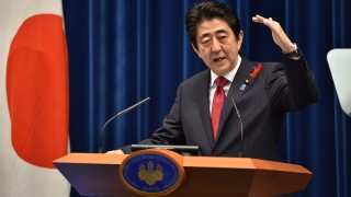 """Japan's Prime Minister Shinzo Abe speaks during a press conference at Abe's official residence in Tokyo on October 6, 2015. Abe said October 5 a dozen nations have reached """"broad agreement"""" on the Trans-Pacific Partnership, which aims to become the world's largest free-trade zone, after days of talks.  AFP PHOTO / KAZUHIRO NOGI"""