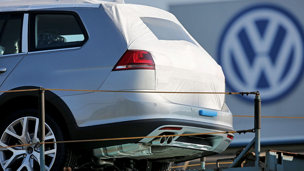 A new VW Golf is seen on a freight train in front of the Mosel Volkswagen factory in Zwickau, Germany, 05 October 2015. The company was plunged into a crisis following revelations it had equipped its diesel-powered vehicles with software designed to rig emissions tests. The consequences for the company are unforseable as of yet. Photo: Jan Woitas/dpa