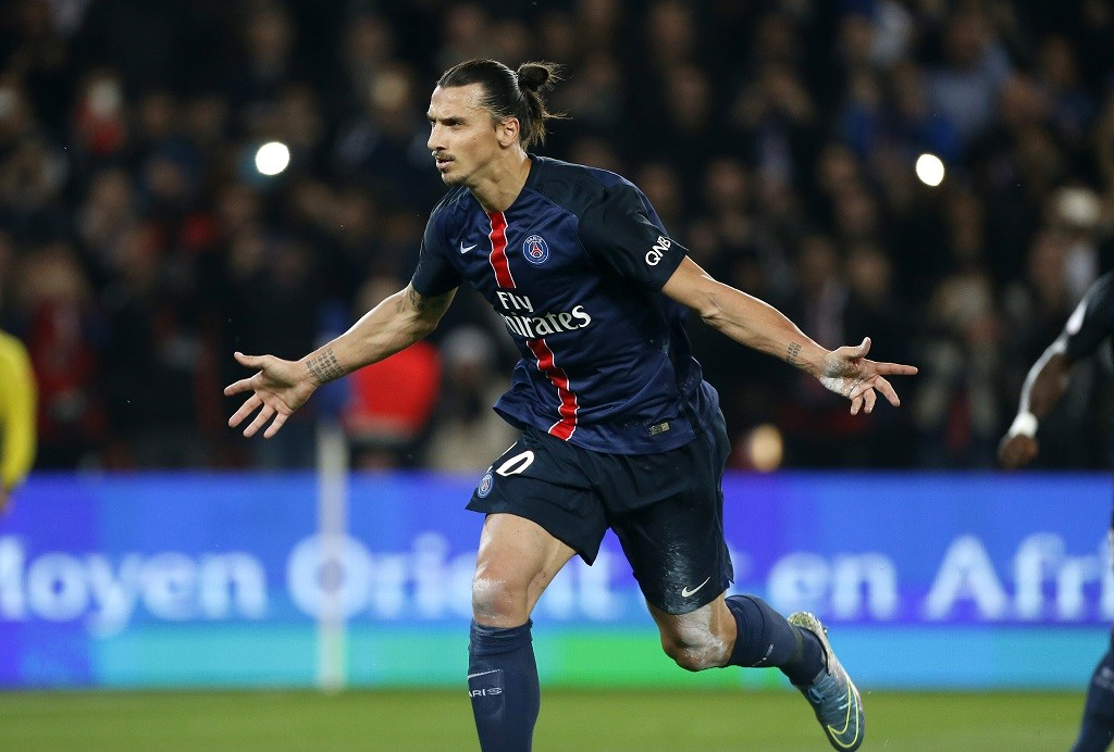 PARIS, FRANCE - OCTOBER 4: Zlatan Ibrahimovic of PSG celebrates scoring a goal during the French Ligue 1 match between Paris Saint-Germain FC (PSG) and Olympique de Marseille at Parc des Princes stadium on October 4, 2015 in Paris, France. (Photo by Jean Catuffe/Getty Images)