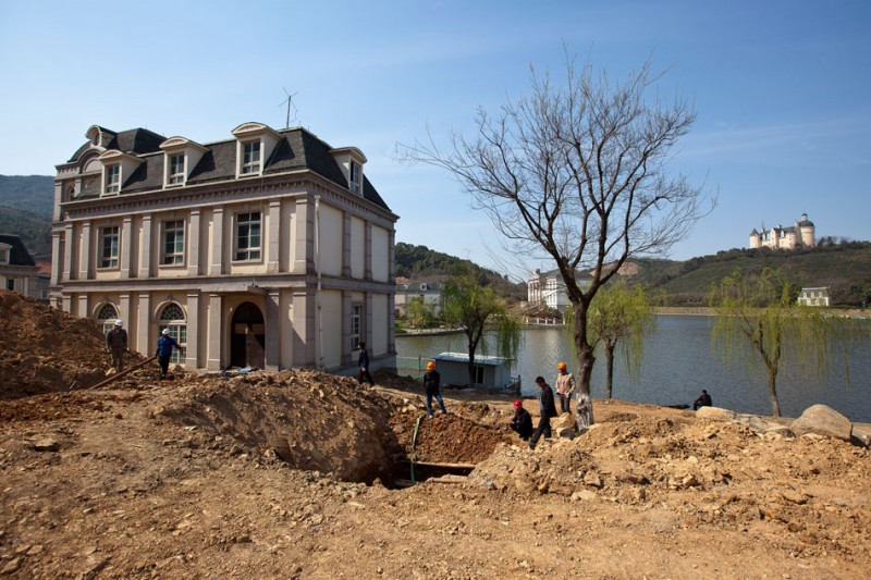 Local laborers work on a villa development attached to the Tianducheng International Holiday Hotel