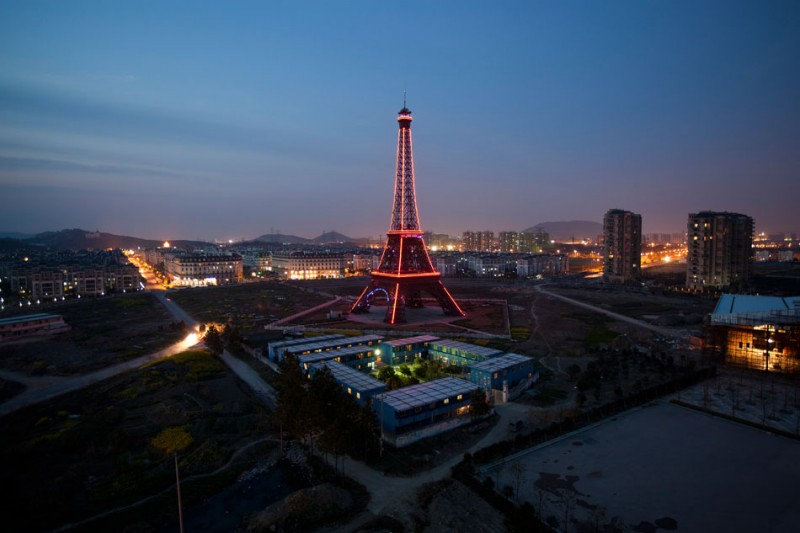 The fake Eiffel Tower lights up the night in Tianducheng