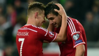 Hungary's captain Balazs Dzsudzsak (L) and scorer Daniel Bode (R) celebrate their victory over Faroe Island after the Euro 2016 Group F qualifying football match between Hungary and Faroe Islands at the Groupama Arena in Budapest, Hungary on October 8, 2015. Hungary won the match 2-1. AFP PHOTO / ATTILA KISBENEDEK