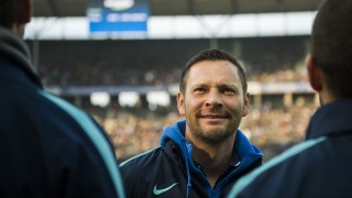 Hertha's Hungarian head coach  Pal Dardai  watches the warm-up prior to the German first division Bundesliga football match Hertha BSC Berlin vs Borussia Moenchengladbach at the Olympic Stadium in Berlin, on October 31, 2015.     AFP PHOTO / ODD ANDERSEN  RESTRICTIONS: DURING MATCH TIME: DFL RULES TO LIMIT THE ONLINE USAGE TO 15 PICTURES PER MATCH AND FORBID THE IMAGE SEQUENCES TO SIMULATE VIDEO. == RESTRICTED TO EDITORIAL USE ==  FOR FURTHER QUERIES PLEASE CONTACT DFL DIRECTLY AT + 49 69 650050