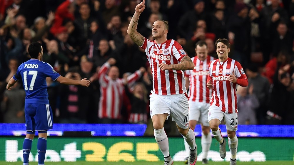 Stoke City's Austrian striker Marko Arnautovic (C) celebrates after scoring the opening goal of the English Premier League football match between Stoke City and Chelsea at the Britannia Stadium in Stoke-on-Trent, central England on November 7, 2015. AFP PHOTO / PAUL ELLIS  RESTRICTED TO EDITORIAL USE. No use with unauthorized audio, video, data, fixture lists, club/league logos or 'live' services. Online in-match use limited to 75 images, no video emulation. No use in betting, games or single club/league/player publications..