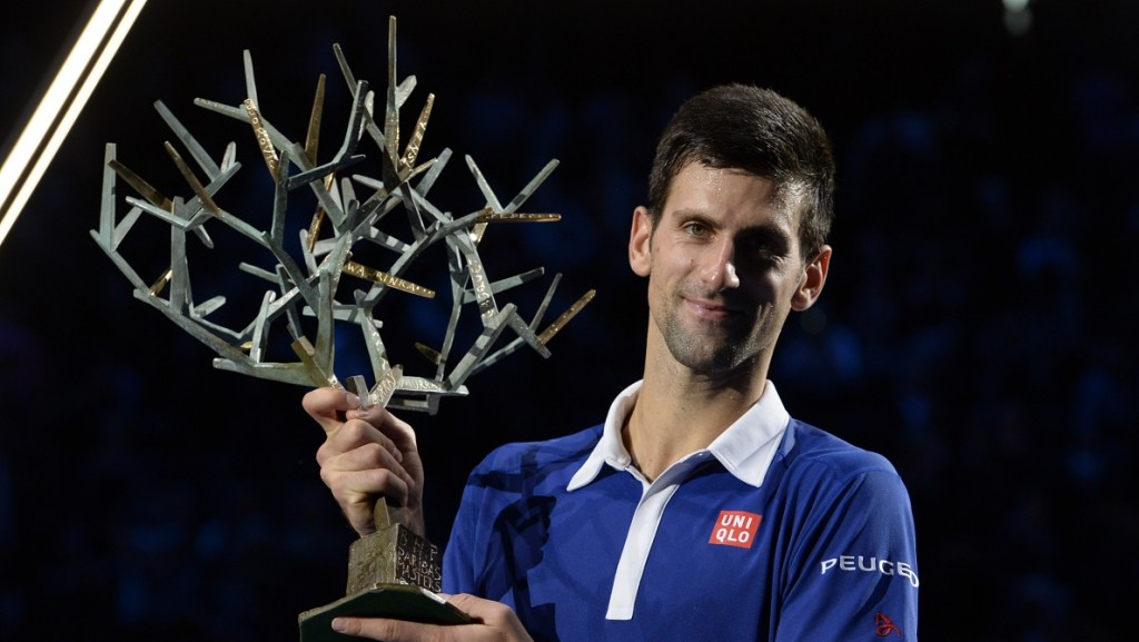 Serbia's Novak Djokovic poses with the trophy after winning the final tennis match at the ATP World Tour Masters 1000 indoor tennis tournament in Paris on November 8, 2015. AFP PHOTO / MIGUEL MEDINA