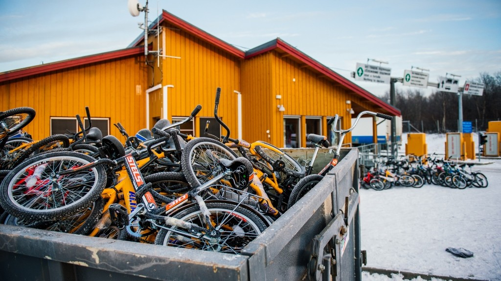 Bikes used by refugees to cross the border from Russia to the Norwegian border crossing station at Storskog are pictured after they were thrown into a recycling container on November 12, 2015 near Kirkenes in northern Norway. An increasingly popular route for migrants across Russia and into Norway has Oslo angered and worried as winter approaches, while commentators suspect Moscow is deliberately creating problems for its neighbour. Initially, the news that migrants were making a long detour through the Arctic had a whimsical quality to it: migrants have to make the last section of their journey by bicycle because Russian authorities don't let pedestrians cross the border and Norway considers it human trafficking to transport migrants in a vehicle.       AFP PHOTO / JONATHAN NACKSTRAND