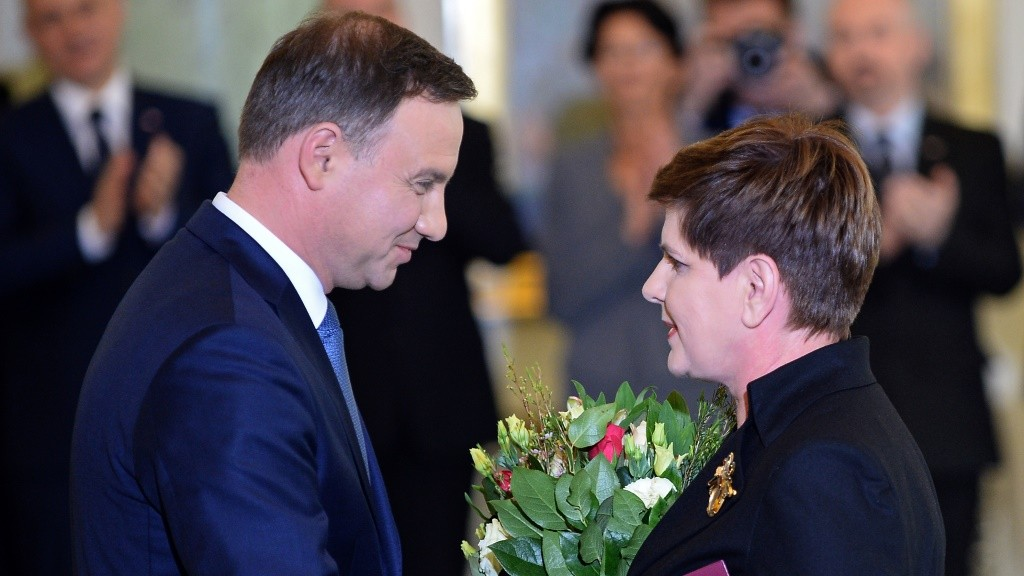 """Polish President Andrzej Duda (L) nominates Beata Szydlo from PiS (Law and Justice) party as Poland's Prime Minister on November 13, 2015 in Warsaw. Poland's new conservative Prime Minister-designate Beata Szydlo vowed to """"fix"""" her EU country Friday after allied President Andrej Duda formally nominated her head of government. AFP PHOTO / JANEK SKARZYNSKI"""