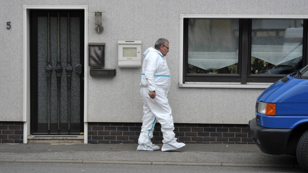 """An investigation officer leaves a house on November 13, 2015 in Wallenfels, southern Germany, where the bodies of """"probably seven"""" infants were discovered the day before. The bodies were found during a visit by emergency services, police said, but did not give any details of the circumstances of their deaths.  AFP PHOTO / MARCUS SCHEIDEL"""