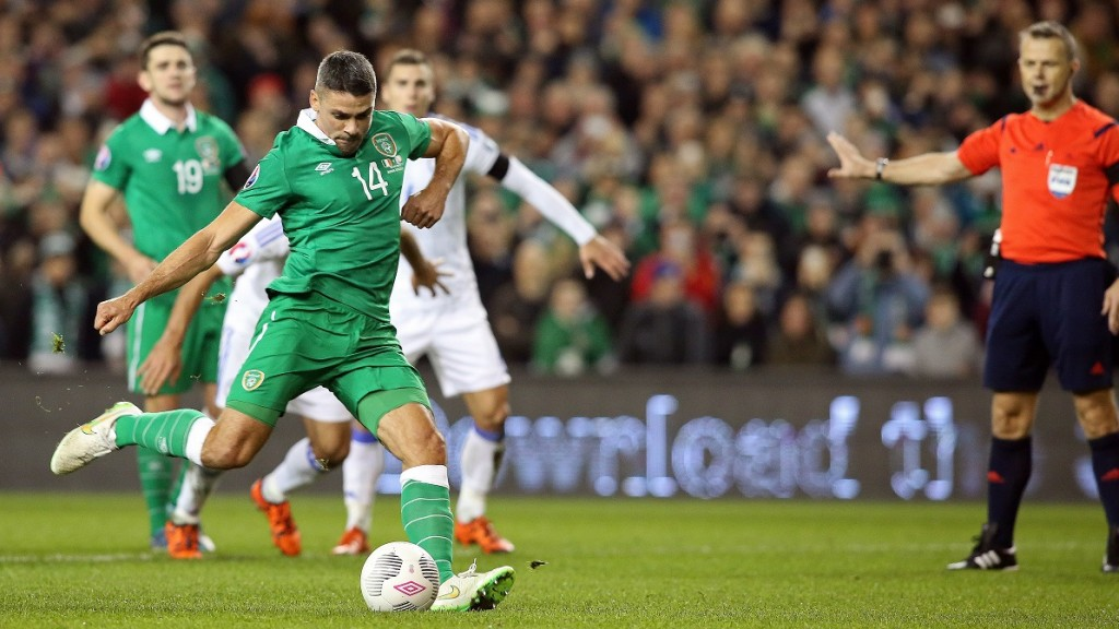 Ireland's striker Jonathan Walters shoots to score his team's first goal, from a penalty during a UEFA Euro 2016 Group D qualifying second leg play-off football match between Ireland and Bosnia Herzegovina at the Aviva stadium in Dublin on November 16, 2015.  AFP PHOTO / PAUL FAITH