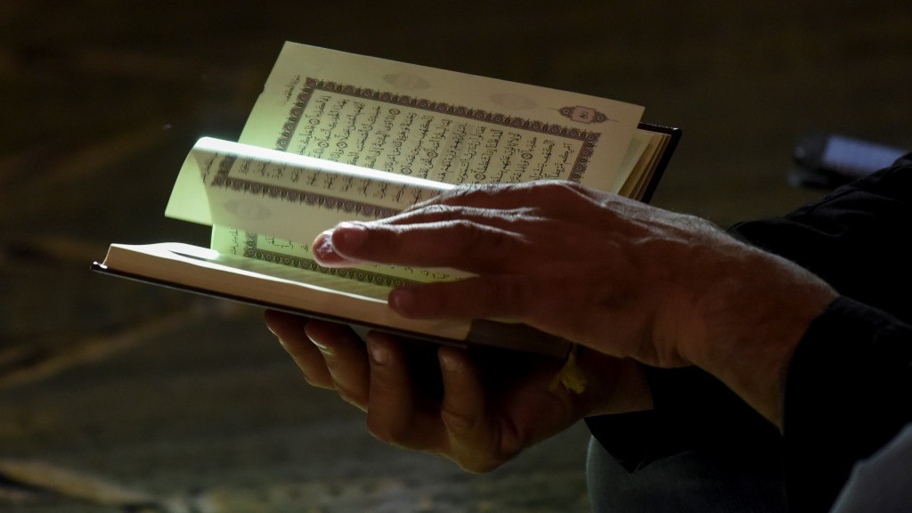A man reads the Quran at the Omar mosque in the Islamic Cultural Center of Madrid on November 20, 2015. AFP PHOTO / PEDRO ARMESTRE / AFP / PEDRO ARMESTRE