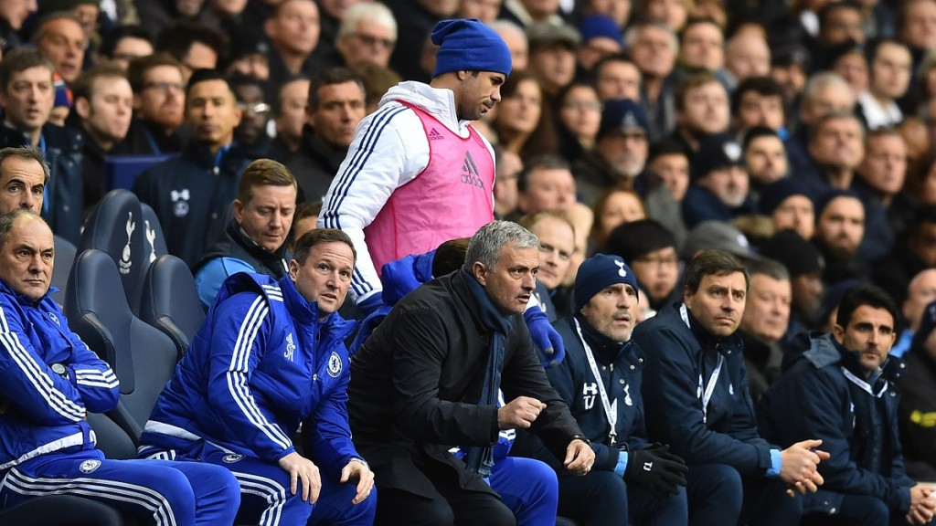 Chelsea's Brazilian-born Spanish striker Diego Costa (top) passes Chelsea's Portuguese manager Jose Mourinho as he goes to warm up during the English Premier League football match between Tottenham Hotspur and Chelsea at White Hart Lane in north London on November 29, 2015.     AFP PHOTO / BEN STANSALL  RESTRICTED TO EDITORIAL USE. No use with unauthorized audio, video, data, fixture lists, club/league logos or 'live' services. Online in-match use limited to 75 images, no video emulation. No use in betting, games or single club/league/player publications. / AFP / BEN STANSALL