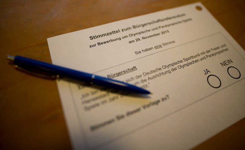A ballot of a referendum whether Hamburg should push ahead to host the 2024 Olympics is pictured at a polling station in Hamburg, northern Germany on November 29, 2015. The port city is in the race against rivals Budapest, Paris, Los Angeles and Rome to stage the Summer Games, with the International Olympic Committee (IOC) due to announce their decision on September 13, 2017. AFP PHOTO / DPA / AXEL HEIMKEN   GERMANY OUT / AFP / DPA / AXEL HEIMKEN